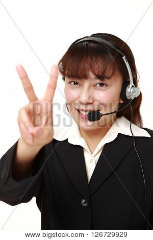 studio shot of Asian Businesswoman showing a victory sign