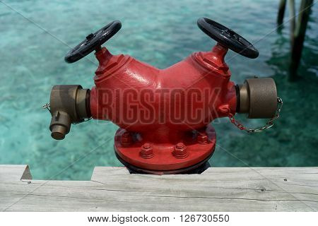 Red Fire hydrant on the seashore at resort