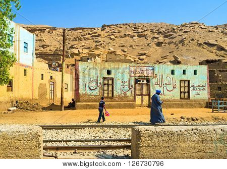 AL QARAYA EGYPT - OCTOBER 7 2014: The old village building decorated with the inscriptions of Quran surahs on October 7 in Al Qaraya.