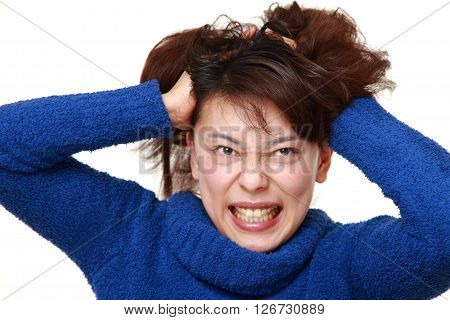 portrait of demented woman on white background