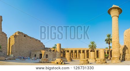 LUXOR EGYPT - OCTOBER 7 2014: Panorama of the courtyard of the Karnak Temple with the side colonnades and ruins of the massive columns on October 7 in Luxor.