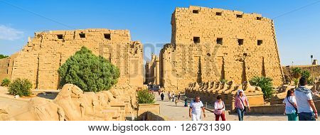 LUXOR EGYPT - OCTOBER 7 2014: The First Pylon of the Karnak Temple and the scenic alley of Ram Headed Sphinxes on October 7 in Luxor.