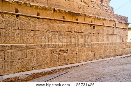 The wall of the Khonsu Temple with the ancient hieroglyphs and pictures Karnak Complex Luxor Egypt.