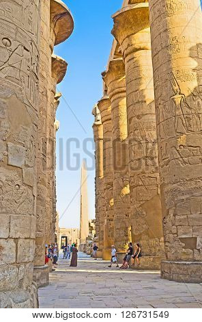 LUXOR EGYPT - OCTOBER 7 2014: The huge columns of the Hypostyle Hall in Karnak Temple covered with the ancient reliefs with hieroglyphs and stories about Gods and Pharaohs on October 7 in Luxor.