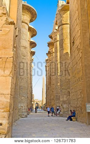 LUXOR EGYPT - OCTOBER 7 2014: The way among the rows of giant columns of the Hypostyle Hall in Karnak Temple on October 7 in Luxor.