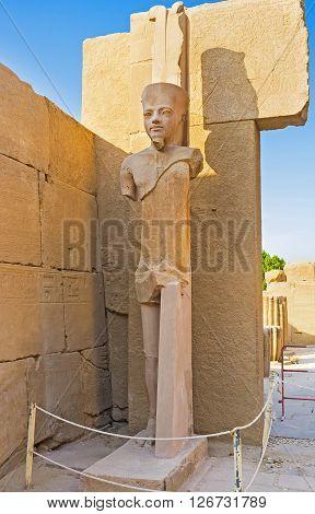 The scenic pharaoh statue located in Fourt Pylon of Karnak Temple Luxor Egypt.