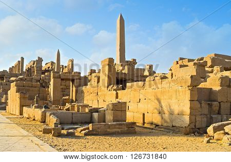 The ruins of Karnak Temple Complex with the rising granite obelisks on the background Luxor Egypt.