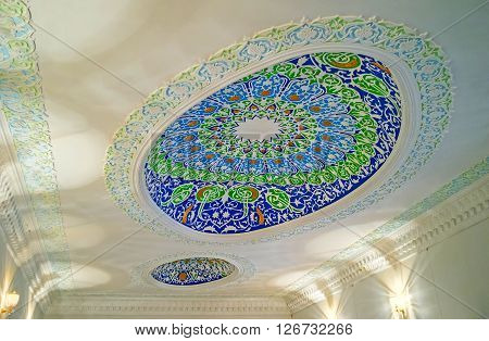 KOKAND UZBEKISTAN - MAY 6 2015: The plaster ceiling with the oval domes in Museum of Jami Mosque on May 6 in Kokand.