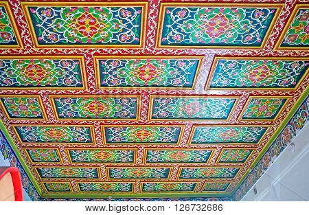 KOKAND UZBEKISTAN - MAY 6 2015: All the rooms in Khudayar Khan Palace boasts unique ceilings' decorations including carvings and painted patterns with floral geometric stellar motives on May 6 in Kokand.