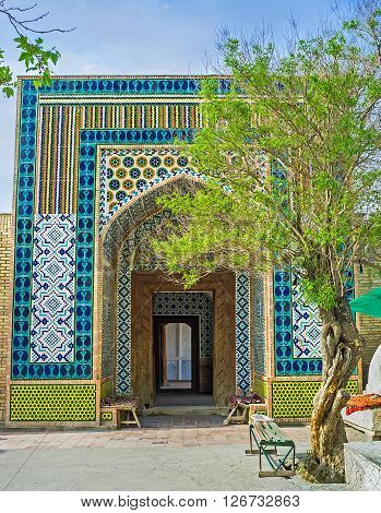 The colorful portal of Damoi Shakhon Burial Vault decorated with the islamic patterns of glazed tiles Kokand Uzbekistan.