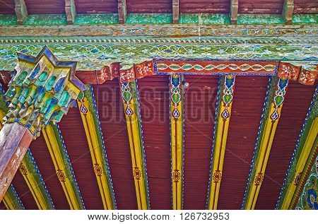 KOKAND UZBEKISTAN - MAY 6 2015: The painted arabesques on the ceiling of Khudayar Khan Palace on May 6 in Kokand.