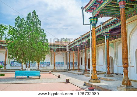 KOKAND UZBEKISTAN - MAY 6 2015: The main courtyard of Khudayar Khan Palace welcomes tourists and represents the architectural ensemble of the mansion on May 6 in Kokand.