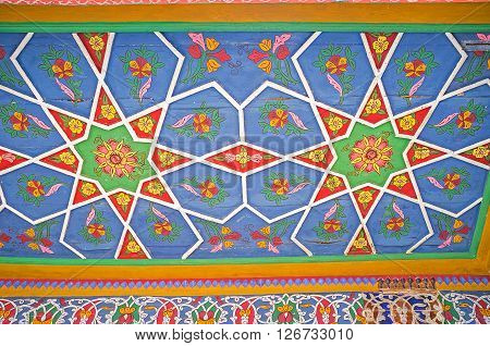 KOKAND UZBEKISTAN - MAY 6 2015: The ceiling in Khudayar Khan Palace covered with the unique patterns with the octagonal stars on May 6 in Kokand.