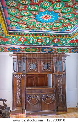 KOKAND UZBEKISTAN - MAY 6 2015: The interior of the residential room in Khudayar Khan Palace with the old wooden furniture on May 6 in Kokand.