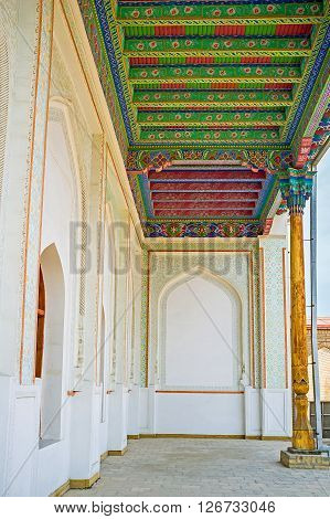 KOKAND UZBEKISTAN - MAY 6 2015: The courtyard of Khudayar Khan Palace with the colorful wooden ceiling and white walls on May 6 in Kokand.