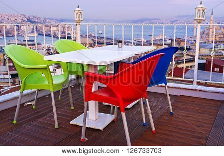 The colorful chairs on the roof of one of the tourists cafe in Fatih district Istanbul Turkey.