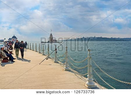 ISTANBUL TURKEY - JANUARY 21 2015: The Uskudar embankment is the best place to enjoy the Maiden's Tower on January 21 in Istanbul.