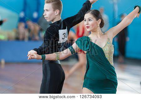 Minsk Belarus -April 3 2016: Levkovich Aleksander and Bugakova Evelina Perform Juvenile-2 Latin-American Program on IDSA Championship Kinezis Star Cup - 2016 in April 3 2016 in Minsk Republic of Belarus