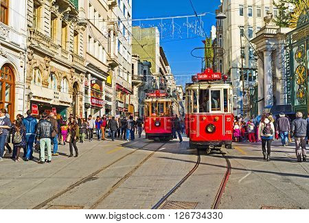 ISTANBUL TURKEY - JANUARY 22 2015: The retro red trams in Independence Avenue are the main tourist attraction in this neighborhood on January 22 in Istanbul.