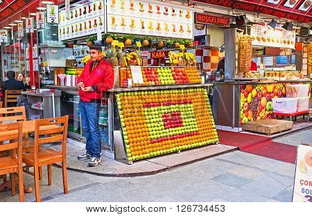 ISTANBUL TURKEY - JANUARY 21 2015: The Egyptian Bazaar boasts comfortable street cafes offering shawarma fresh juices hot coffee and tea on January 21 in Istanbul.