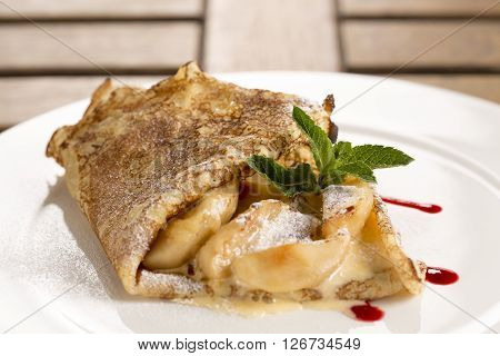 Apple Pancakes with Calvados sabayon and raspberry compote