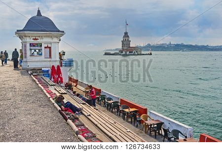 ISTANBUL TURKEY - JANUARY 21 2015: The cozy teahouse on the Uskudar embankment offers the hot beverages and scenic view on Bosphorus and the Maiden's Tower on January 21 in Istanbul.