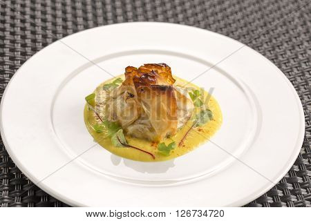 Filo parcel of goat's cheese, squash, yellow pepper coulis