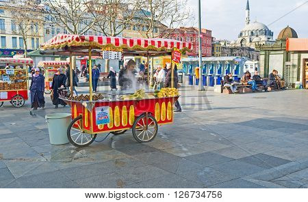 ISTANBUL TURKEY - JANUARY 21 2015: The favorite Turkish street snacks are the hot corn and the roasted chestnuts on January 21 in Istanbul.