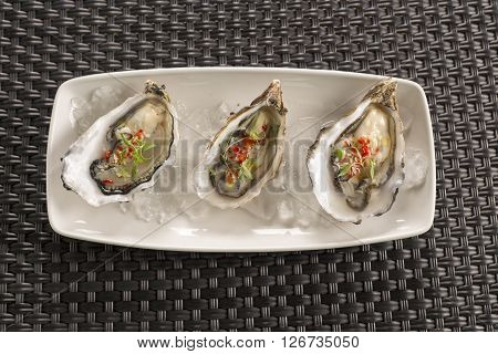 Malden oysters with chilli, ginger & rice wine vinegar