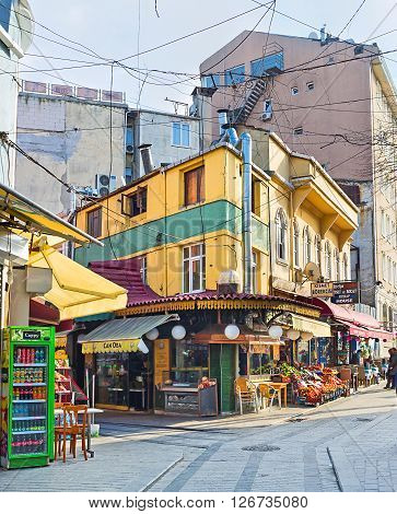 ISTANBUL TURKEY - JANUARY 21 2015: The bright yellow corner house with the mini market on the ground flooe located next to the bazaar on January 21 in Istanbul.