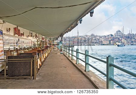 ISTANBUL TURKEY - JANUARY 21 2015: The Galata vridge is the nice place for fishing enjoy the city vews and relax in the local cafe or fish restaurant on January 21 in Istanbul.
