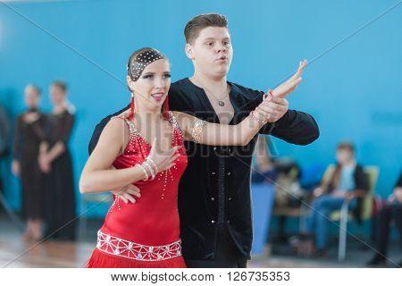 Minsk Belarus -April 3 2016: Sokol Iliya and Bartashevich Kristina Perform Juvenile-2 Latin-American Program on IDSA Championship Kinezis Star Cup - 2016 in April 3 2016 Minsk Republic of Belarus