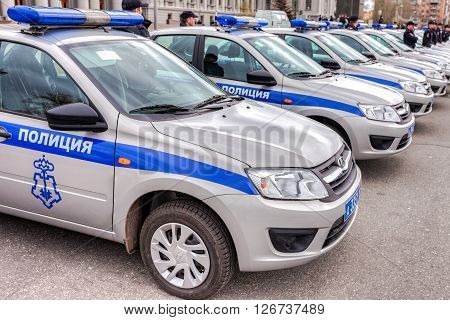 SAMARA RUSSIA - APRIL 20 2016: Russian police patrol vehicles parked on the Kuibyshev square in spring day