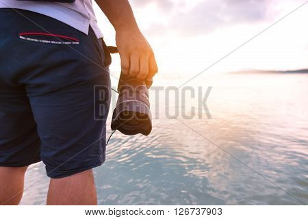 Man holding his camera on during his travel. photographer and travel concept.