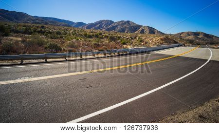 Bend in a road through the desert of the American southwest.