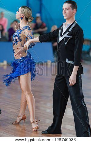 Minsk Belarus -April 3 2016: Belyavskiy Vladislav and Belan Dariya Perform Youth Latin-American Program on IDSA Championship Kinezis Star Cup - 2016 in April 3 2016 in Minsk Republic of Belarus