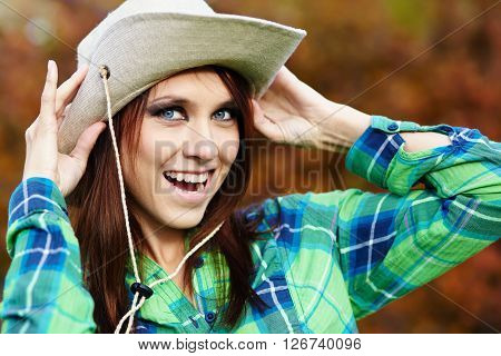 portrait of an attractive smiling country girl in hat