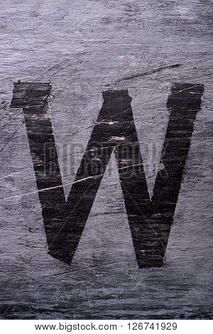Black grunge alphabet sticky tape effect.Letter W