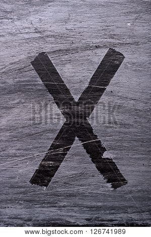 Black grunge alphabet sticky tape effect.Letter X