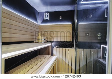 Modern Finnish sauna with neon lights. Beautiful interior home finnish sauna room.