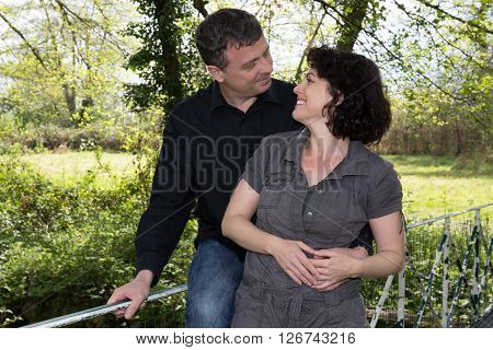 Middle Aged Couple Outdoors Looking At Each Other