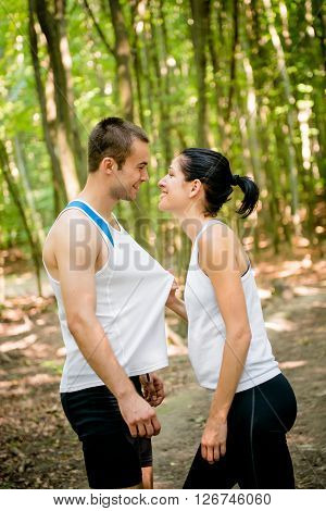 Sport couple together in nature having great time
