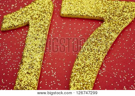 Number seventeen yellow color over a red background. Anniversary. Horizontal