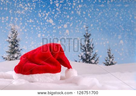 Symbolic Red Santa hat on snow backgroung