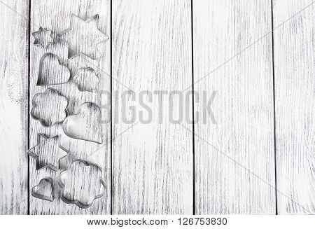 various cookies cutters on a old wooden table