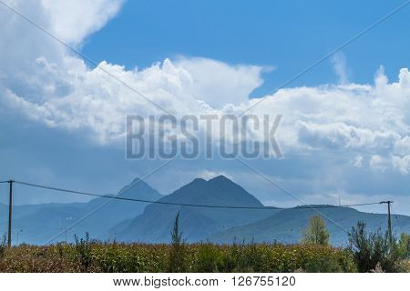 Mountainous landscape, corn field and lush nature in autumn in Yunnan, China.