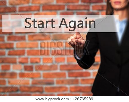 Start Again - Businesswoman Hand Pressing Button On Touch Screen Interface.