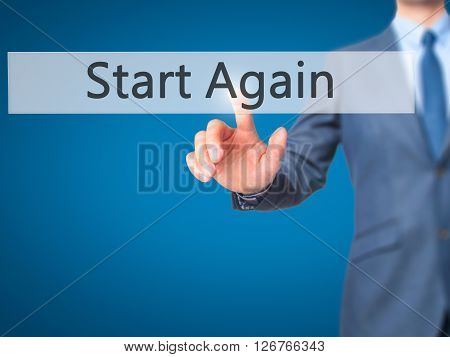 Start Again - Businessman Hand Pressing Button On Touch Screen Interface.