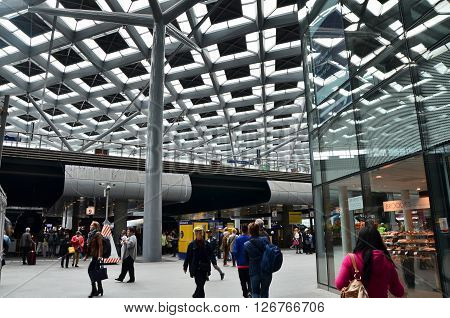 The Hague Netherlands - May 8 2015: Crowd at central Station of The Hague Netherlands on May 8 2015. The station is the largest railway station in The Hague.