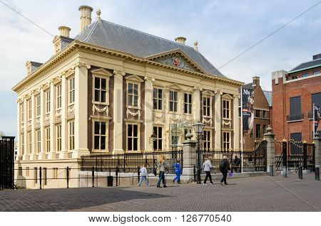 The Hague Netherlands - May 8 2015: Tourist visit Mauritshuis Museum in The Hague Netherlands. The museum houses the Royal Cabinet of Paintings which consists of 841 objects mostly Dutch Golden Age paintings.